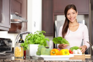 girl in kitchen with veggies
